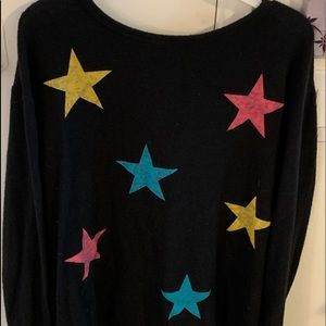 Black sweater with colored stars. Loose fit.